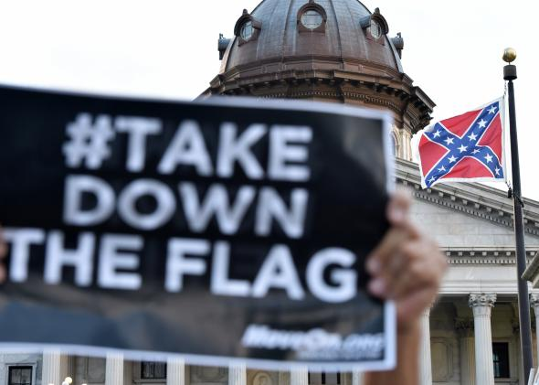 477933854-hundreds-of-people-protest-against-the-confederate-flag.jpg.CROP.promo-mediumlarge