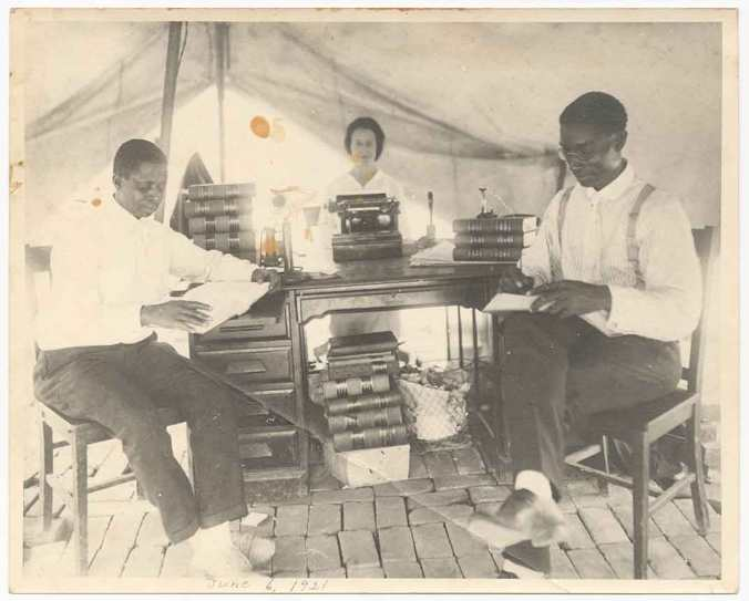 Practicing law in a Red Cross tent, Buck C. Franklin (right) on June 6, 1921, five days after the massacre. (National Museum of African American History and Culture, Gift from Tulsa Friends and John W. and Karen R. Franklin)