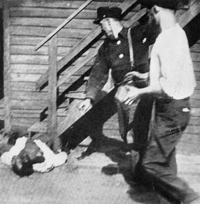 Riot in Chicago, July 1919. Two white men stoning an African American to death. Public Domain
